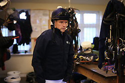 23rd November 2017 - Michael Owen Horse Racing - Former footballer Michael Owen waits in the tack room as he prepares to take to the gallops at Manor House Stables in Cheshire ahead of his first ever race as a jockey - Photo: Simon Stacpoole / Offside.