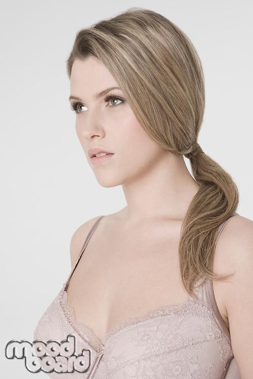 Sexy young woman wearing bra