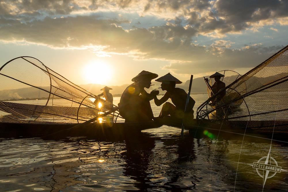 Fishermen gather at sunset for a smoking break on Inle Lake in Myanmar.