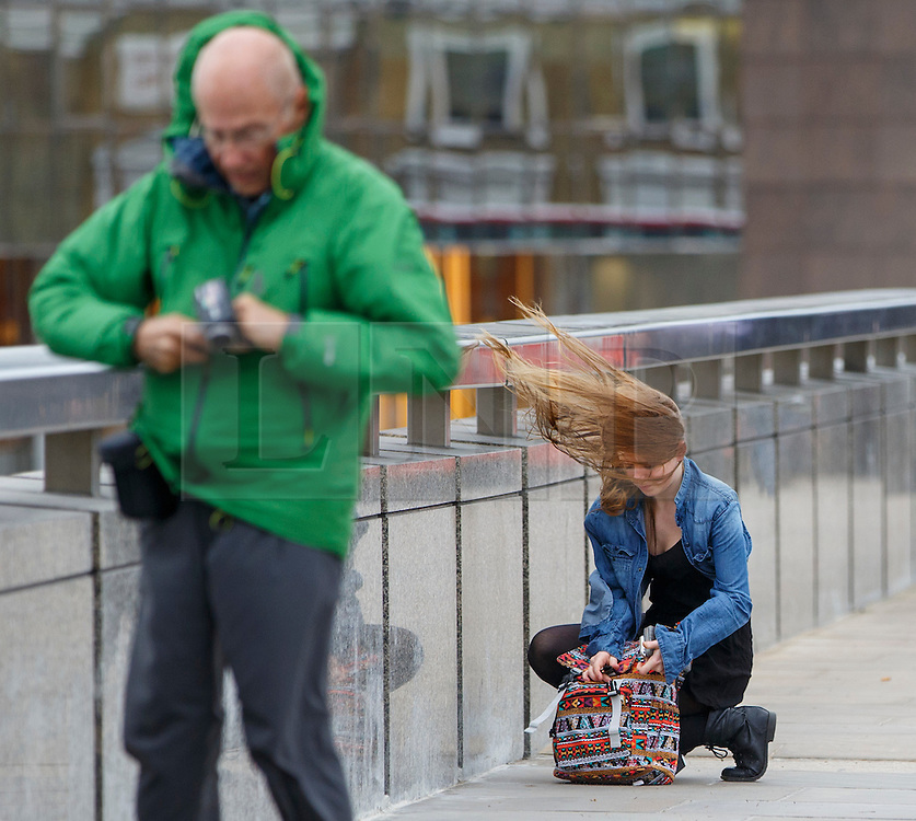 © Licensed to London News Pictures. 02/06/2015. London, UK. Commuters walking against strong wind on London Bridge on Tuesday, 2 June 2015 in London. Photo credit: Tolga Akmen/LNP
