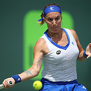 Svetlana Kuznetsova of Russia returns a shot against Serena Williams of the United States during their match at the Miami Open tennis tournament at Crandon Park on Monday, March 30, 2015 in Key Biscayne, Florida. Williams won the match 6-2, 6-3. (AP Photo/Alex Menendez)