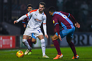 Andrew Shinnie of Luton Town (11) takes on Funso Ojo of Scunthorpe United (6) during the EFL Sky Bet League 1 match between Scunthorpe United and Luton Town at Glanford Park, Scunthorpe, England on 26 December 2018.