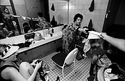 Strippers sitting around the dressing room chatting, Western Australia, 2000's
