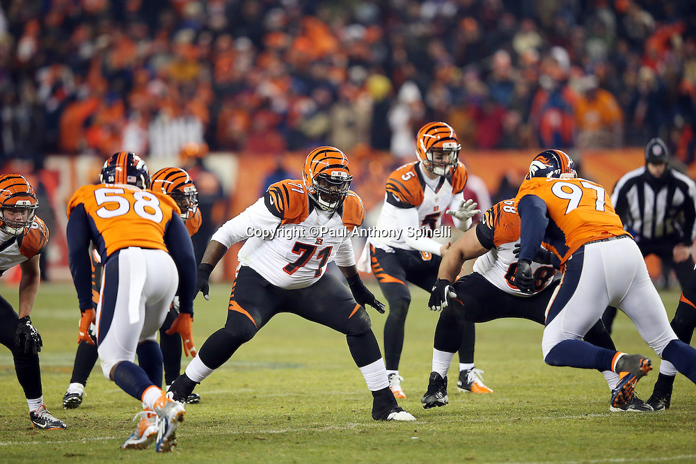 Cincinnati Bengals tackle Andre Smith (71) pass blocks during the 2015 NFL week 16 regular season football game against the Denver Broncos on Monday, Dec. 28, 2015 in Denver. The Broncos won the game in overtime 20-17. (©Paul Anthony Spinelli)