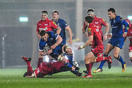 Leinster's Sean O'Brien is tackled by Scarlets' Will Boyde<br /> <br /> Photographer Craig Thomas/Replay Images<br /> <br /> Guinness PRO14 Round 17 - Scarlets v Leinster - Friday 9th March 2018 - Parc Y Scarlets - Llanelli<br /> <br /> World Copyright © Replay Images . All rights reserved. info@replayimages.co.uk - http://replayimages.co.uk