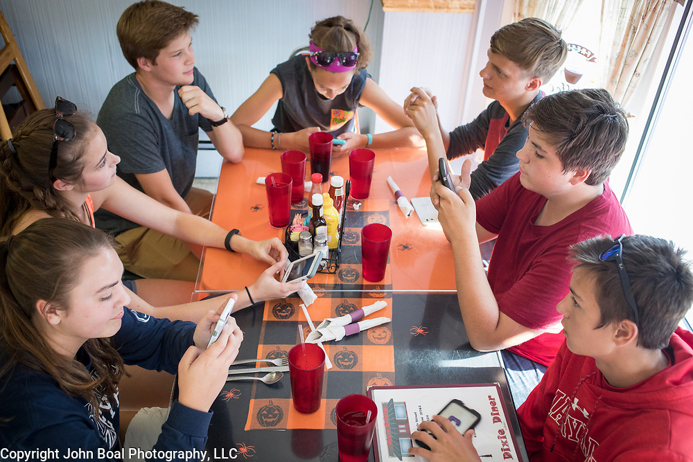 Clockwise from lower left, fellow Smithsburg High School Marching Band members, Haley Mapes, 17, Hannah Yoder, 17, Adam Smith, 15, Stephanie Lewis, 15, Logan Shank, 15, Joe Fouke, 16, and Chase Mapes, 16 gathered at the Dixie Diner in Smithsburg, Maryland, onTuesday, September 26, 2017. Maryland's 6th Congressional district was redistricted in 2011, switching out rural northwest Maryland regions for more affluent communities like Potomac and Germantown. <br /> CREDIT: John Boal for The Wall Street Journal<br /> GERRYMANDER