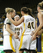 08 February 2007: Iowa forward Krista VandeVenter (51), guard Lindsey Nyenhuis (50), and center Stacy Schlapkohl (40) in Iowa's 66-49 win over Michigan at Carver-Hawkeye Arena in Iowa City, Iowa on February 8, 2007.