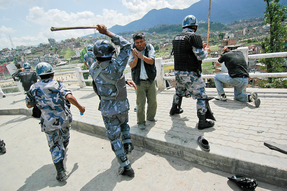 Police attack protesters in Kathmandu, Nepal. 4/21/2006 Photo by Ben Depp