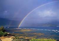 Morning rainbow over the reef at the St. Regis and Hanalei