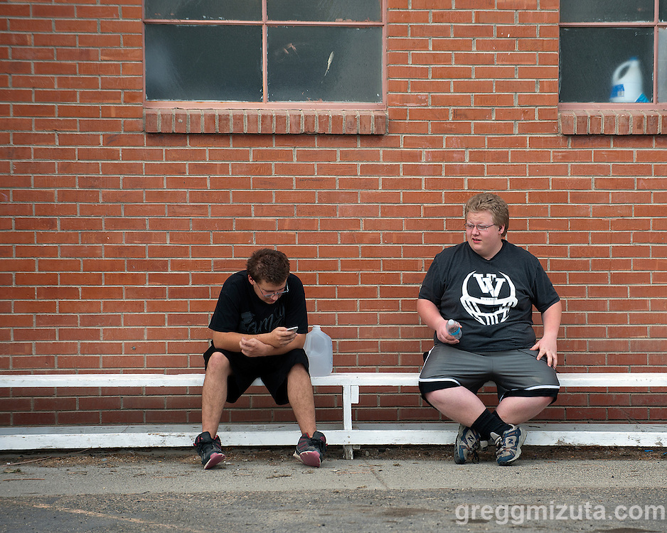 Chaz Tanner and Nate Nipper outside of the locker room before the start of the Vale - Baker football game, September 26, 2014 at Vale, Oregon. Vale won 58-28 to improve its season record to 4-0.