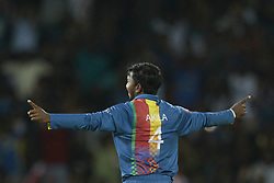 March 12, 2018 - Colombo, Sri Lanka - Sri Lankan cricketer Akila Dananjaya  celebrates after taking a wicket  during the 4th Twenty-20 cricket match of NIDAHAS Trophy between Sri Lanka  and India at R Premadasa cricket ground, Colombo, Sri Lanka on Monday 12 March 2018. (Credit Image: © Tharaka Basnayaka/NurPhoto via ZUMA Press)