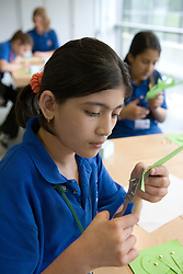 School pupils working on project in classroom,