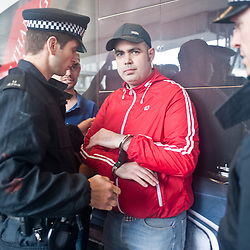 London, UK - 29 June 2013: a man gets arrested after assaulting EDL leaders Tommy Robinson and Kevin Carroll trying to march through London borough of Tower Hamlets
