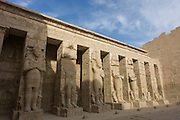 Minus tourists, the tall Ramessid columns in the peristyle court at the ancient Egyptian site of Medinet Habu (1194-1163BC), the Mortuary Temple of Ramesses III in Luxor, Nile Valley, Egypt. Medinet Habu is an important New Kingdom period structure in the West Bank of Luxor in Egypt. Aside from its size and architectural and artistic importance, the temple is probably best known as the source of inscribed reliefs depicting the advent and defeat of the Sea Peoples during the reign of Ramesses III.