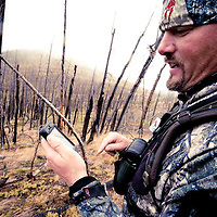 bow hunter, hunter iphone, hunting looking at map on iphone, elk deer hunting, mountains of montana burn area, fall hunting, bow hunter in the field hunting old burn in western mountains