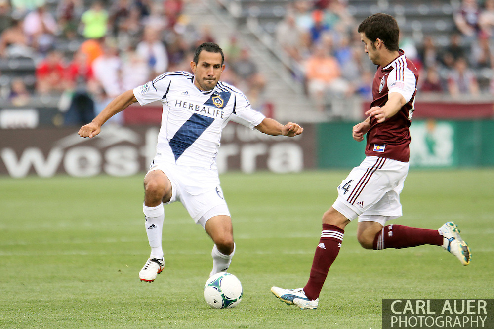 July 27th, 2013 - LA Galaxy midfielder Pablo Mastroeni (6) and Colorado Rapids midfielder Nathan Sturgis (24) go after the ball in the second half of action in the Major League Soccer match between the LA Galaxy and the Colorado Rapids at Dick's Sporting Goods Park in Commerce City, CO