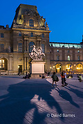 France, Paris (75), Louvre at dusk with the statue of Louis XIV