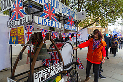 """A woman bangs a drum on a float the demands """"Britains sovereignty back"""" as MPs debate and later vote of Prime Minister Theresa May's Brexit Deal. London, January 15 2019."""