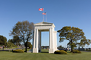 "The Peace Arch (1921) looking towards the United States.  Photographed from Peace Arch Provincial Park in Surrey, British Columbia, Canada.  The Peace Arch was built in 1921 to commemorate the 100 year anniversary of treaties at the end of the War of 1812 between the USA and Great Britain. One side states ""Children Of A Common Motherr"", the other ""Brethren Dwelling Together In Unity""."