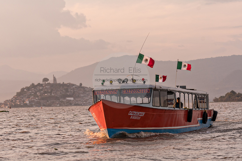 Ferry boats carry tourists on Lake Patzcuaro near Janitzio Island, Michoacan, Mexico.