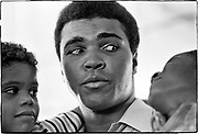 Muhammad Ali - 5th St Gym/Miami Beach, FL      Tri-X     September 1970<br /> training/workout prior to fighting Jerry Quarry in Atlanta (Oct 1970);<br /> Craig (3-1/2 yrs old-godchild) &amp; Anthony (7 yrs old) Armbrister