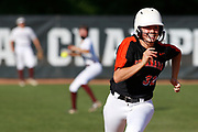 Escanaba shortstop Taylor Gauthier (32) is all smiles as she runs to third base during an MHSAA Division 2 softball state semifinal game between Escanaba and Eaton Rapids at Michigan State University in East Lansing, Mich., on Thursday, June 14, 2018.