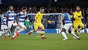 Leeds United midfielder Alex Mowatt attacks the  QPR end, only to be stopped by QPR Defender Nedum Onuoha (captain) during the Sky Bet Championship match between Queens Park Rangers and Leeds United at the Loftus Road Stadium, London, England on 28 November 2015. Photo by Andy Walter