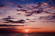 An intense Hawaiian sunset off Waikiki Beach.