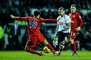 Bradley Johnson of Derby County (centre) is stopped by Ben Marshall of Blackburn Rovers (left) during the Sky Bet Championship match at the iPro Stadium, Derby<br /> Picture by Andy Kearns/Focus Images Ltd 0781 864 4264<br /> 24/02/2016