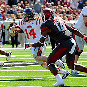 Mississippi quarterback Bo Wallace (14) runs the ball during an NCAA college football game against Arkansas in Little Rock, Ark., Saturday, Oct. 27, 2012. (Photo/Thomas Graning)