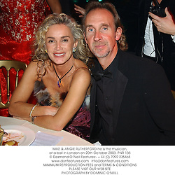 MIKE & ANGIE RUTHERFORD he is the musician, at a ball in London on 20th October 2003.PNR 135