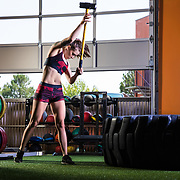 Carly Andrew poses for a fitness photo on Friday, July 3, 2018 at American Iron Gym in Reno, Nev.