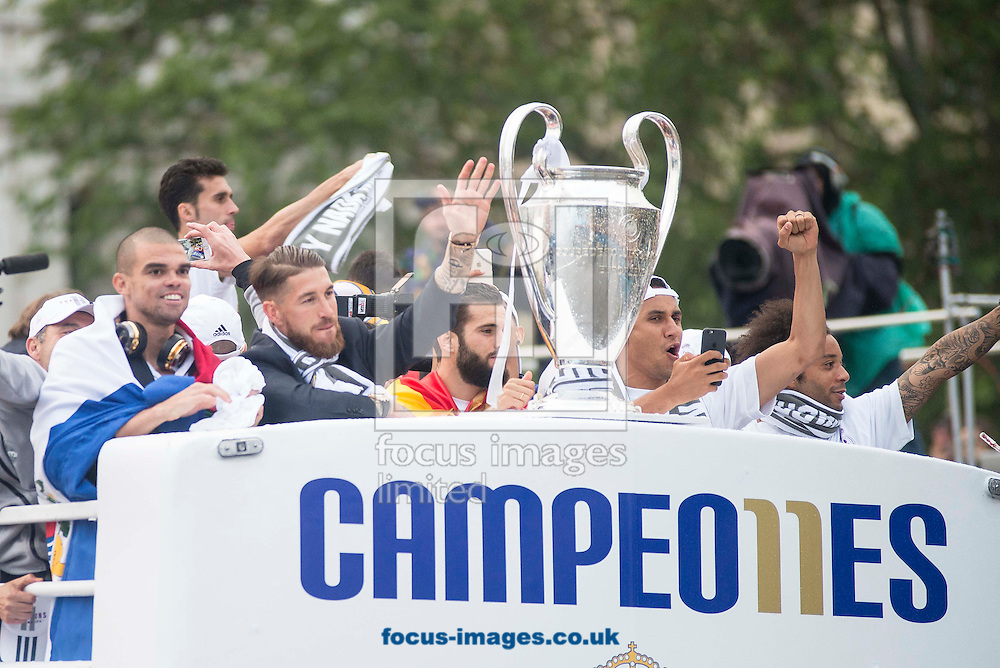 Real Madrid players celebrate winning the UEFA Champions League with an open top bus tour at Cibeles Square, Madrid<br /> Picture by EXPA Pictures/Focus Images Ltd 07814482222<br /> 29/05/2016<br /> ***UK &amp; IRELAND ONLY***<br /> EXPA-ESP-160529-0111.jpg