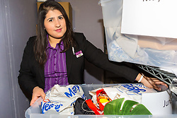 Assistant Manager Bruna Salvadori holds a crate of lost property in the Premier Inn Smithfield lost property room. London, July 24 2019.