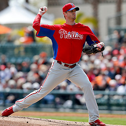 Mar 3, 2013; Sarasota, FL, USA; Philadelphia Phillies starting pitcher Kyle Kendrick (38) throws against the Baltimore Orioles during the bottom of the first inning of a spring training game at Ed Smith Stadium. Mandatory Credit: Derick E. Hingle-USA TODAY Sports