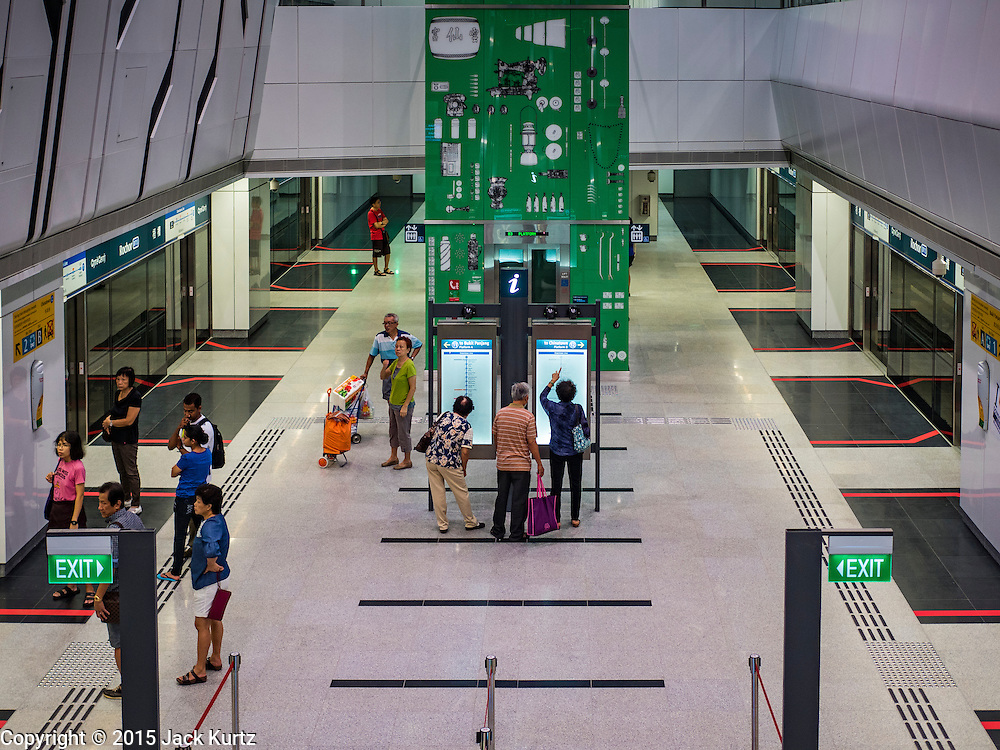 "27 DECEMBER 2015 - SINGAPORE, SINGAPORE:  People look at subway schedules in the Rochor subway station in the Little India section of Singapore on the first day the station was open. Singapore opened the extension of the Downtown Line on its subway system Sunday. The extension is a part of Singapore's plans to make the city-state a ""car lite"" metropolis with plans to double the current subway to more than 360 kilometers of track by 2030. The government plans to have 80% of homes within a 10 minute walk of a subway station.   PHOTO BY JACK KURTZ"