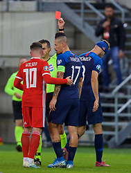 TRNAVA, SLOVAKIA - Thursday, October 10, 2019: Slovakia's Norbert Gyömber (R) reacts as he is shown a second yellow card, then a red, and sent off during the UEFA Euro 2020 Qualifying Group E match between Slovakia and Wales at the Štadión Antona Malatinského. (Pic by David Rawcliffe/Propaganda)