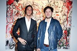 Left to right, Vladimir Restoin Roitfeld and artist Nicolas Pol at a private view of Nicolas Pol's paintings entitled 'Mother of Pouacrus' held at The Dairy, Wakefield Street, London WC1 on 14th October 2010.