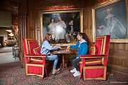 Two redheaded girls play chess inside Ashford Castle, a 13th century castle turned into a 5 star luxury hotel located in Cong, Ireland.