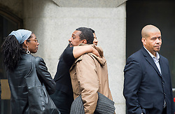 © Licensed to London News Pictures. 10/06/2015. London, UK. Family and friends of Azelle Rodney hug outside The Old Bailey in London where former Met specialist firearms officer Anthony Long is currently standing trial accused of murdering Azelle Rodney in April 2005. Rodney died after officers stopped the car he was travelling in with two other men in Edgware, north London. Photo credit: Ben Cawthra/LNP