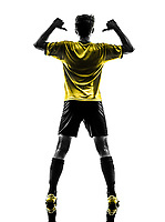 one Brazilian soccer football player young man rear view portrait pointing in silhouette studio on white background