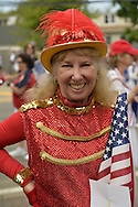 Merrick, New York, U.S. - May 26, 2014 - Senior dancers in red costumes marched in the Merrick Memorial Day Parade and Ceremony, hosted by American Legion Post 1282 of Merrick, honoring those who died in war while serving in the United States military.