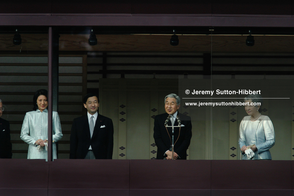 """The Japanese Imperial family appear on the balcony of the Imperial Palace to greet the public below, to welcome the New Year of 2007, in Tokyo, Japan, on Tuesday, Jan. 2, 2007. Left to right: Crown Princess Masako, Crown Prince Naruhito, Emperor Akihito and Empress Michiko. 70,000 well-wishers entered the East Palace Gardens to greet the Imperial family who appear on the Palace's Chowa-Den wing balcony. Accompanied by his siblings and his children and their wives the Emperor waved and said """"I wish for the happiness of people in our country and peace in the world"""". This appearance by the Imperial family is one of two opportunties the Japanese public have to greet them, the other being the Emperor's birthday 23rd, December."""