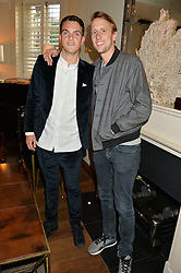 Left to right, VISCOUNT ERLEIGH and GEORGE FROST at a private view of the Beulah Winter Autumn Winter collection entitled 'Chrysalis' held at The South Kensington Club, London SW7 on 24th September 2015.