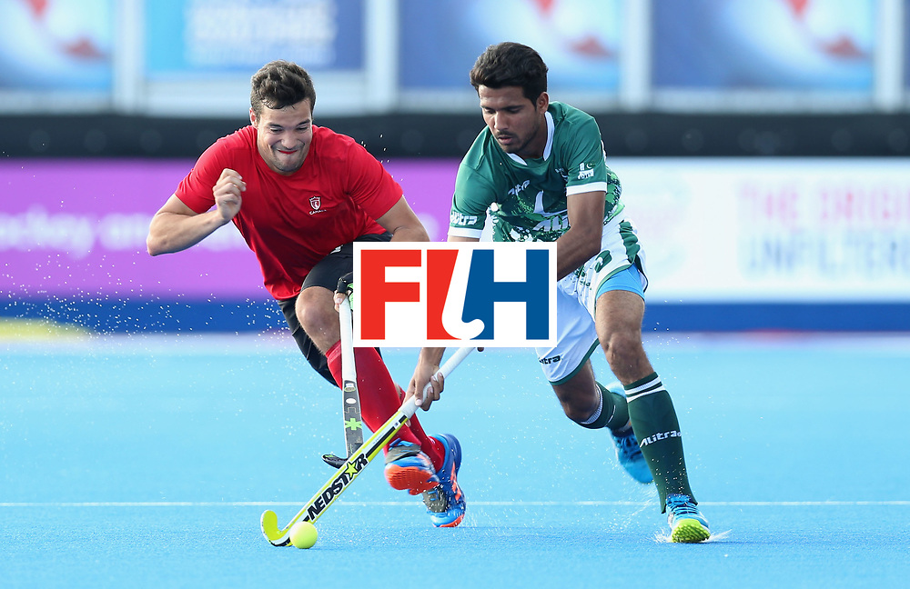 LONDON, ENGLAND - JUNE 16:  Muhammad Mushtaq of Pakistan is chased by Matthew Sarmento of Canada during the Hero Hockey World League Semi-Final Pool B match between Pakistan and Canada at Lee Valley Hockey and Tennis Centre on June 16, 2017 in London, England.  (Photo by Alex Morton/Getty Images)