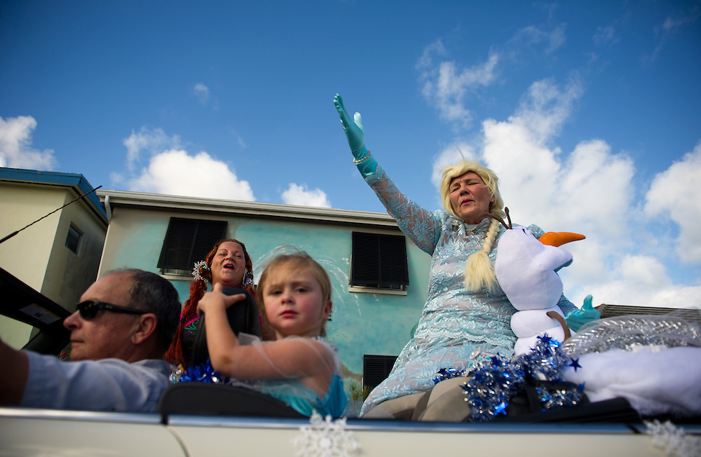 "Xavier Mascareñas/Treasure Coast Newspapers; Karen Schmid (right) dressed as Elsa from the Disney movie ""Frozen,"" and Lesley Vestrich (left of center) dressed as Anna, sing ""Let it Go"" from the popular animated feature during the Hobe Sound Christmas Parade in Hobe Sound on Saturday, Dec. 6, 2014. Vestrich's husband, Phil Hudanish, drives and granddaughter Eryn Lawson, also dressed as Elsa, rides along on Bridge Road in the Always Best Care Senior Services of Hobe Sound parade car."
