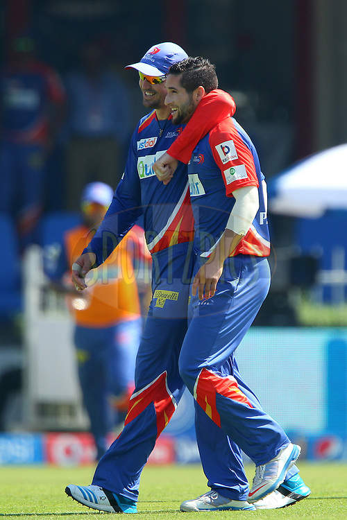 Kevin Pietersen captain of of the Delhi Daredevils congratulates Wayne Parnell on the wicket of Aditya Tare of the Mumbai Indians during match 16 of the Pepsi Indian Premier League 2014 between the Delhi Daredevils and the Mumbai Indians held at the Sharjah Cricket Stadium, Sharjah, United Arab Emirates on the 27th April 2014<br /> <br /> Photo by Ron Gaunt / IPL / SPORTZPICS