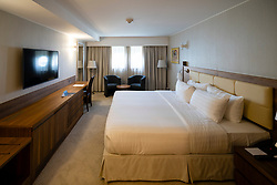 Bedroom in former cabin of Queen Elizabeth 2 former ocean liner now reopened as hotel in Dubai , United Arab Emirates