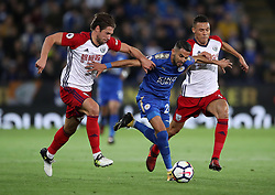 Leicester City's Riyad Mahrez breaks through West Bromwich Albion's Grzegorz Krychowiak and Kieran Gibbs (right) during the Premier League match at the King Power Stadium, Leicester.