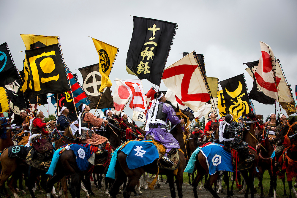 "MINAMISOMA, JAPAN - JULY 24 : A samurai horsemen look for the sacred flag as they compete in the Shinki-soudatsusen (sacred flag competition) during the Soma Nomaoi festival at Hibarigahara field on Sunday, July 24, 2016 in Minamisoma, Japan. ""Soma-Nomaoi"" is a traditional festival that recreates a samurai battle scene from more than 1,000 years ago.  (Photo: Richard Atrero de Guzman/NURPhoto)"
